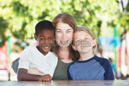 mother hugging and sitting with boys