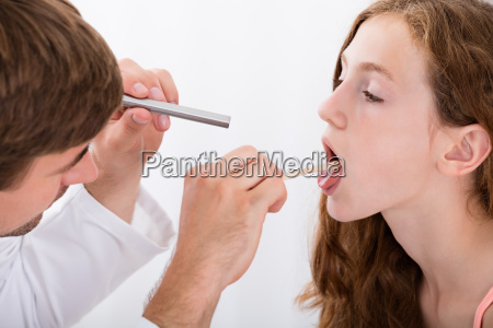 close up of doctor examining girls