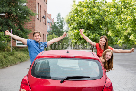 family looking out of a car