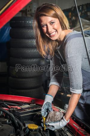 lovely female car mechanic in auto