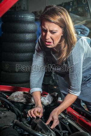 female car mechanic in auto repair