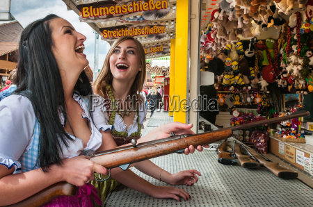 two lovely girls playing shooting games