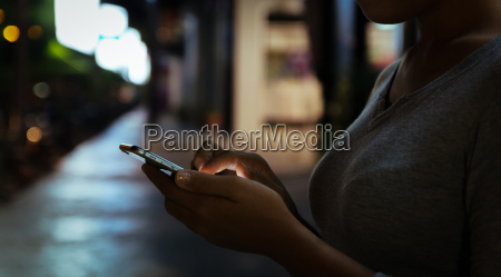 close up woman use phone on