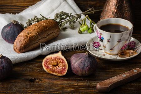light breakfast with coffee bun and