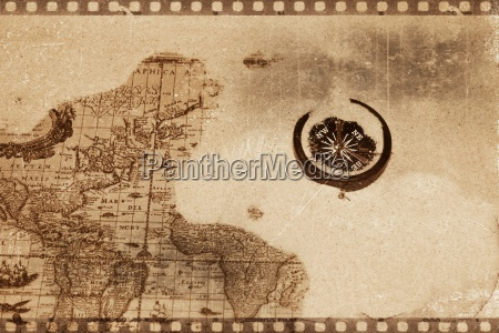 compass lies on old map
