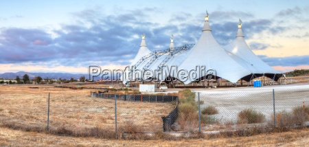full moon over a circus tent