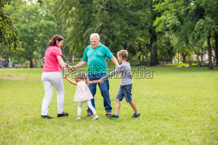 grandparents playing with their grandchildren