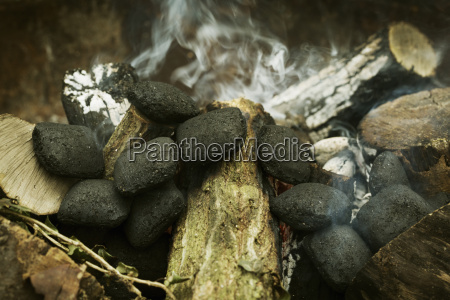 close up of charcoal briquettes on
