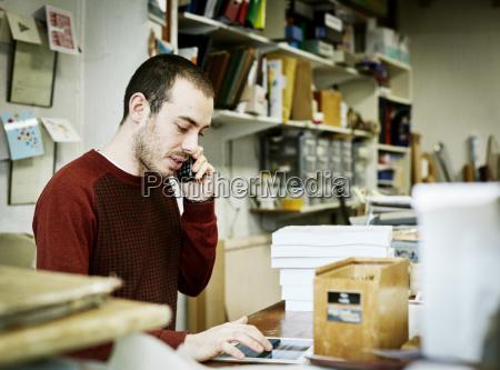 a man using a smart phone