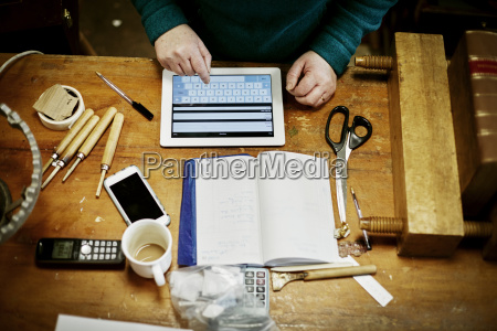 a person sitting at a workbench