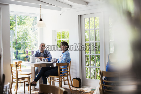 two people seated at a coffee