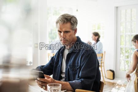 man sitting in a coffee shop
