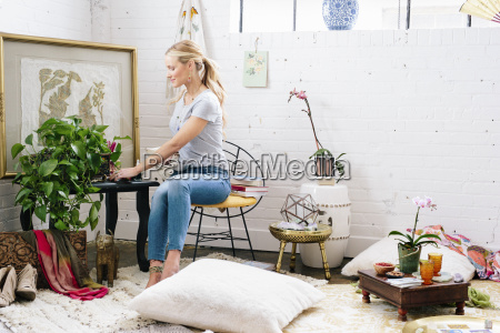 a young woman sitting on a