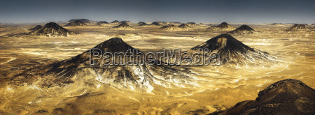 a vast desert landscape with mountains