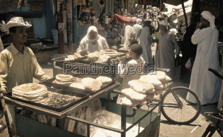 vendors selling bread at a traditional