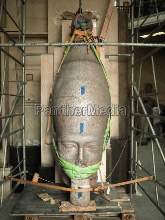 a crumbling sculpture undergoing restoration