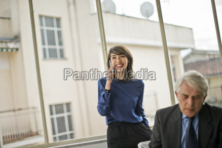 smiling young businesswoman talking on her