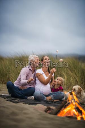 three generations of women enjoy toasting