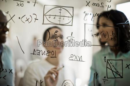mathmeticians working to solve equation