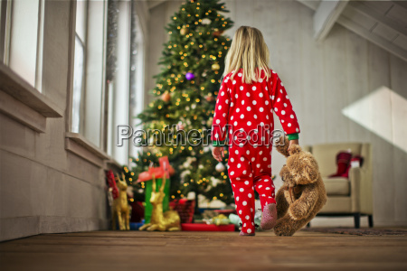 young girl walking towards the christmas