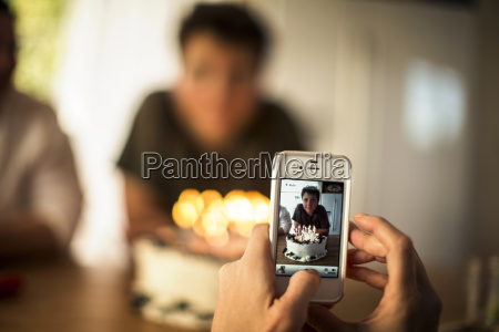 mother takes a photograph of her