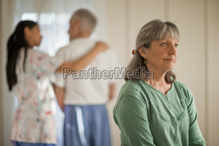 senior woman looking thoughtful while a