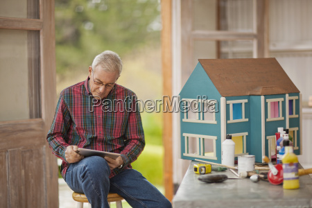 senior man looking at an ipad