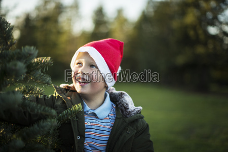 smiling young boy standing next to