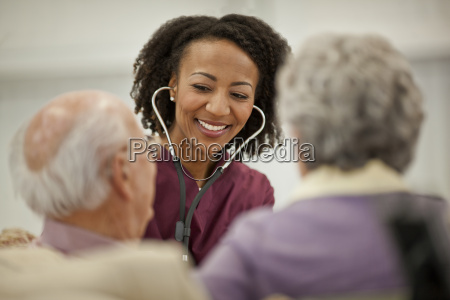 smiling young nurse listening to an