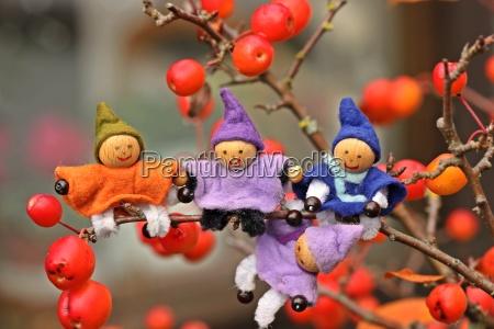 four small gnome sitting in bonsai