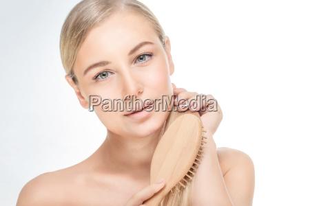 beautiful woman combing her hair