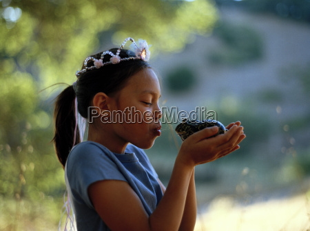 young girl wearing a princess crown