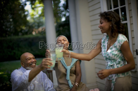 mature couple sharing a toast with