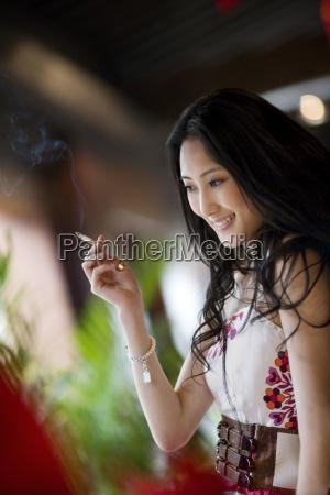 young adult woman smoking