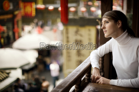 young adult woman sitting at a