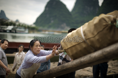 chinese workers working loading cargo
