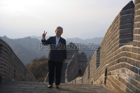 businesswoman giving the peace sign at