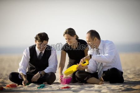 a man pours the sand from