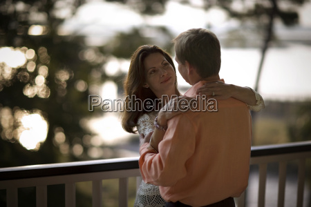 mid adult couple standing together on