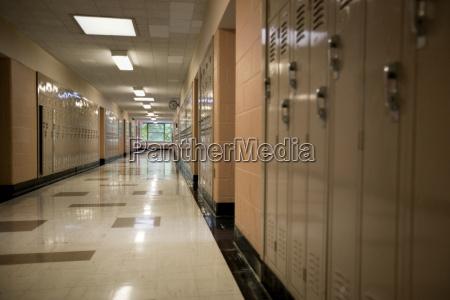 lookers inside an empty school corridor