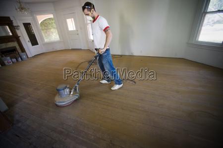 male, builder, buffing, floorboards, inside, a - 19269799