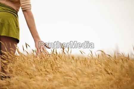 teenage girl running her hand through