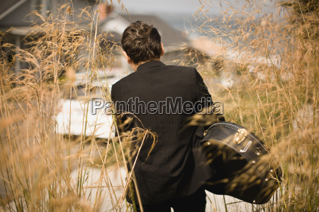 boy in a suit and carrying