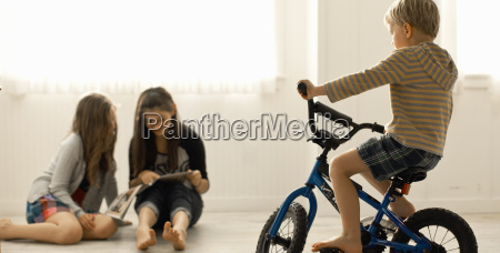 two young girls sitting together on