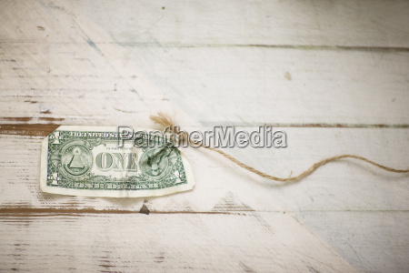 american dollar bill tied to the