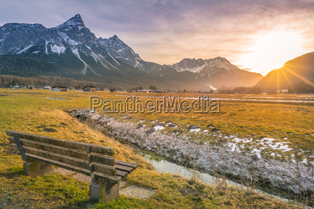 wooden bench on mountain valley