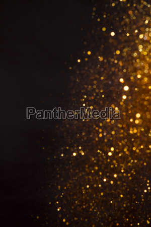 background of golden lights with bokeh