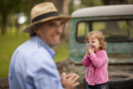 mature man laughing with his toddler