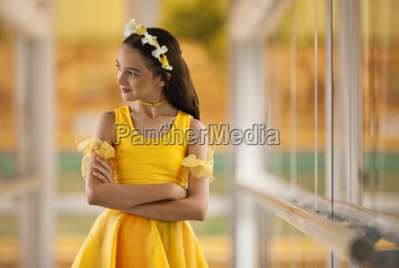 tween girl standing with arms crossed