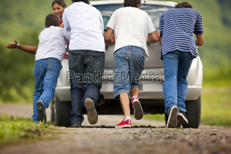 four boys helping by pushing the